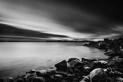 Frozen in time (Rico the noob) Tags: 2018 rock d850 landscape finland water outdoor lake stones clouds longexposure published beach 20mm monochrome travel rocks blackandwhite sky bw dof 20mmf18 nature ice