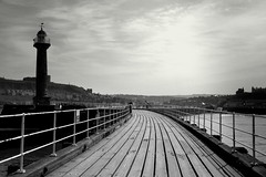 Towards the bay (John (Thank you for >2 million views)) Tags: whitby pier lighthouse leadingline walkway monochrome landscapephotography bw blancoynegro coastaluk ukcoast seaside bay thursdaymonochrome