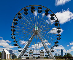 The Big Wheel (Kool Cats Photography over 12 Million Views) Tags: wheels streetphotography sky puffy photography photo oklahomacity oklahoma landscape daylight clouds city canoneos6d canon canonef24105mmf4lis bluesky blue atmosphere artistic architecture ferriswhell