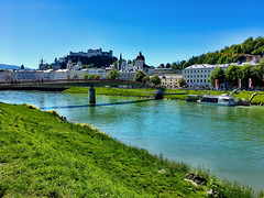 Salzburg in May (echumachenco) Tags: salzburg salzach austria österreich sky blue grass water green spring may cathedral dom festung castle fortress hohensalzburg kollegienkirche universitätskirche altstadt city medieval baroque bridge makartsteg house building architecture wolfdietrich parislodron iphone boat amadeus