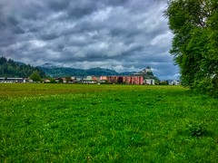Kufstein with Fortress in Tyrol, Austria (UweBKK (α 77 on )) Tags: kufstein fortress field meadow green grass tree landscape sky clouds grey tyrol tirol austria europe europa iphone österreich