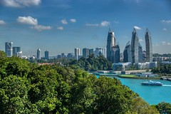 Keppel Bay seen from Siloso Skywalk on Sentosa island in Singapore (UweBKK (α 77 on )) Tags: keppel bay fort siloso skywalk sentosa island ferry water sky blue tree forest condominium apartment building house architecture singapore southeast asia sony alpha 77 slt dslr
