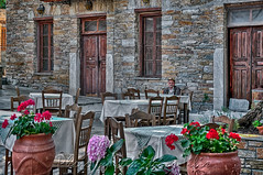 Αναμονή χωρίς προσδοκία                              Waiting but not expecting (Dimitil) Tags: greece hellas pelion thessaly afissos architecture building coastalpelion doors flowers greektradition oldman oldpeople picturesquevillage place stone stonebuilt stonehouses traditionalarchitecture traditionalbuildings traditionalhouses traditionalstonehouses village villagelife street