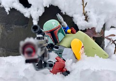 Scoped In (socalbricks) Tags: boba fett bobafett wrist rocket jetpack bounty hunter lego star wars legostarwars cape fountain construction ccbs buildable figure action outdoors 2018 snow scoped scope rifle wait entrenched rock ice cold storm oregon 75533