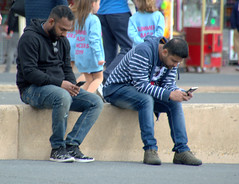 Candid phone use in Blackpool (Tony Worrall) Tags: blackpool resort place england english north northwest visit county town area northern location lancs lancashire uk fylde fyldecoast coastal tour country welovethenorth nw update attraction open stream item greatbritain britain british gb capture buy stock sell sale outside outdoors caught photo shoot shot picture captured ilobsterit instragram street streetphotography urban candid people person picturesinthestreet photosofthestreet phones couple sit watch