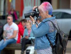 Photographing the photographer in Blackpool (Tony Worrall) Tags: blackpool resort place england english north northwest visit county town area northern location lancs lancashire uk fylde fyldecoast coastal tour country welovethenorth street streetphotography urban candid people person capture outside outdoors caught photo shoot shot picture captured picturesinthestreet photosofthestreet camera colourful hair lens