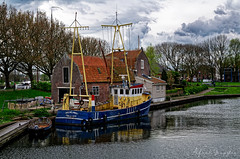 Fisherman's House (Alfred Grupstra) Tags: nauticalvessel netherlands water dutchculture river architecture canal outdoors old harbor amsterdam house history cultures woodmaterial pier builtstructure lake nature travel fishingboat nets