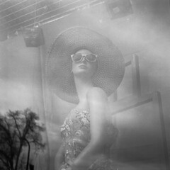 untitled (kaumpphoto) Tags: rolleiflex 120 tlr ilford bw black white street urban city hat reflection tree sky glasses sunglasses neck minneapolis window display face
