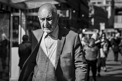 Sunny Side of the Street (Leanne Boulton) Tags: urban street candid portrait portraiture streetphotography candidstreetphotography candidportrait streetportrait streetlife old man male face eyes expression emotion mood feeling atmosphere sunlight cardigan jacket style fashion stubble tone texture detail depthoffield bokeh naturallight outdoor light shade shadow city scene human life living humanity society culture lifestyle people canon canon5dmkiii 70mm ef2470mmf28liiusm black white blackwhite bw mono blackandwhite monochrome glasgow scotland uk