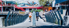 2019 - Vancouver - Lonsdale Quay (Ted's photos - For Me & You) Tags: 2019 bc britishcolumbia canada cropped nikon nikond750 nikonfx tedmcgrath tedsphotos vancouver vancouverbc vancouvercity vignetting bicycles bikers bollard pathway pathsandpeople peopleandpaths northvancouver wideangle widescreen railing mural wallmural