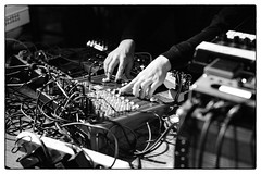Ilpo Väisänen @ Cafe Oto, London, 19th May 2019 (fabiolug) Tags: hand hands synth synthesiser synthesizer electronic electronics ilpoväisänen mikavainio mikavainiobirthdaymemorialbooklaunch pansonic panasonic blastfirst cafeoto london dalston music gig performance concert live livemusic leicammonochrom mmonochrom monochrom leicamonochrom leica leicam rangefinder blackandwhite blackwhite bw monochrome biancoenero zeisscsonnartf1550mmzm zeisszm50mmf15csonnar zeisscsonnar zeisssonnar zeiss sonnar 50mm sonnar50mm 50mmf15