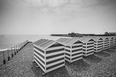 Seaside - Beach huts looking out to Sea (julieloolibelle15) Tags: hastings 2019 may seaside shootfromthehip streets streetphotography england tradition documentary beach lifestyle summer towns people beachhuts pebbles seascape