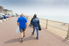 Seaside - Two in Blue (julieloolibelle15) Tags: hastings 2019 may seaside shootfromthehip streets streetphotography england tradition documentary beach lifestyle summer towns people promenade couple walking