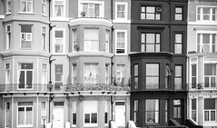 Seaside - Windows (julieloolibelle15) Tags: hastings 2019 may seaside shootfromthehip streets streetphotography england tradition documentary beach lifestyle summer towns people monochrome blackandwhite architecture shapes lines windows abstract t ones