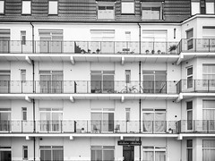 Seaside - Balconies (julieloolibelle15) Tags: hastings 2019 may seaside shootfromthehip streets streetphotography england tradition documentary beach lifestyle summer towns people monochrome blackandwhite architecture lines leadinglines abstract