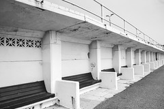 Seaside - Hidden Seats (julieloolibelle15) Tags: hastings 2019 may seaside shootfromthehip streets streetphotography england tradition documentary beach lifestyle summer towns people leadinglines blackandwhite monochrome highcontrast contrast architecture abstract
