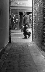 Badger (4foot2) Tags: streetphoto streetshot street streetphotography candid candidportrate reportage reportagephotography people peoplewatching peopleofbrighton interestingpeople alley backstreet laines northlaines analogue film filmphotography 35mmfilm 50mmf2summicron leica leicam3 m3 mono monochrome bw blackandwhite doublex kodakdoublex 5222 kodak rodinal standdevelop 2019 fourfoottwo 4foot2 4foot2flickr 4foot2photostream
