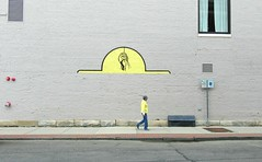 Yellow.Bricks.Road. (Robert Saucier) Tags: berkshires pittsfield rue street sidewalk trottoir pavement jaune yellow fenêtre window vitre glass personne people streetart mur murale mural gris grey rideaux curtains piéton pedestrian img5920