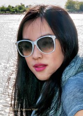 Girl with sunglasses faces camera (tbeckeryvr) Tags: close up portrait young woman girl sunglasses feminine long dark hair outdoor sence red lips poses