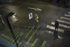 Loop / Krug (MarkoRadinkovic) Tags: man pedestrian crosswalk station road night street light zebra reflection stripes yellow wet rain vancouver canon radinkovic 5d contax zeiss distagon 28mm m42 arrow richmond biritshcolumbia