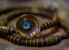 Eye of the beholder (eMMa_bOOm) Tags: macromondays themecopper copper jewelry ring brass bracelets leather leatherwithcopper nigeria souvenir themerelated dark hues colours blue