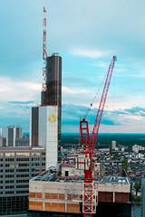 Under Construction (nmkavvada) Tags: frankfurt germany sun sunset skyscaper blue bluecolor urban urbancity urbanphotography