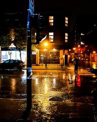 Knox Bar in Rainstorm (Montreal) (MassiveKontent) Tags: nightshot pointsaintcharles city cityscape cityatnight streetphotography montreal bw contrast urban montréal quebec canada silhouette streetlight metropolis color road night reflections building bar knox car streetphoto shadows street metropolitan lights rain sign saturated saturation glow noir