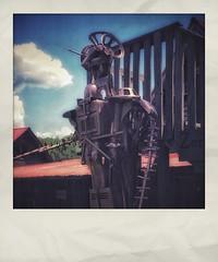 Detail of Folk Sculpture Robot | The Backyard | Fischer Crossroads | Fort Payne, Alabama (steveartist) Tags: fakepolaroids fakeinstantphotos instantapp iphonese snapseed robot monumentalart folkart photostevefrenkel fischercrossroads fortpayneal folkartsculpture metalsculpture recycledmetalparts sky clouds building