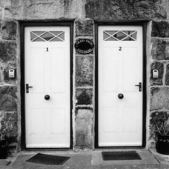 Uniformity (Howie Mudge LRPS BPE1*) Tags: craigfach cottages doors uniformity minoltax700 minoltarokkormc35mmf28 fomapan400 kodakhc110 selfdevelop 12 35mm 35mmfilmphotography 35mmfilmcamera slr singlelensreflex analog film filmphotography filmisnotdead filmcamera filmrevival ishootfilm believeinfilm grain filmgrain