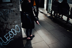 Don't say its over (ewitsoe) Tags: city erikwitsoecome nikond750 sigma35mmart spring street warszawa erikwitsoe everydaylife people poland urban warsaw smoking woman female cinematic waiting onthephone leaning lady polska tramstop traniststation