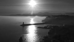 Lighthouse in Nice, France 15/4 2013. (photoola) Tags: nice dimma fyr solnedgã¥ng motljus sv solnedgång fogg mist sunrise photoola france monochrome blackandwhite mediterranean medelhavet
