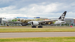 Lord of The Rings 777. (spencer_wilmot) Tags: specialcolours speciallivery specialmarkings 777 777300 777300er 77w b77w b777 b773 widebody nz anz aviation aircraft airplane airliner airport arrival airside apron approach boeing boeing777 tripleseven plane passengerjet jet jetliner heathrow heavy touchdown ramp runway lhr landing london longhaul lhregll landinggear pilot pilots flying flight taxiway twin the airline of middle earth