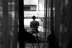 Woman behind the curtain (Leica M6) (stefankamert) Tags: woman curtain silhouette film analog grain mood ilford fp4 summitar leica leicam6 m6 noiretblanc noir blackandwhite blackwhite bw