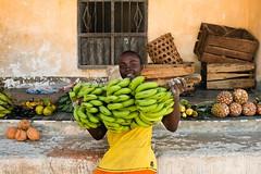 Bananas to sell - Jambiani, Zanzibar (.sl.) Tags: jambiani people portrait streetphotograghy tanzanie zanzibar banana yellow streetportrait street fruit window house tanzania africa