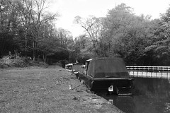 Whaley Bridge Wharf facing towards Bugsworth    (Peak Forest Canal)   May 2019 (dave_attrill) Tags: barge moored basin wharf whaleybridge peakforest canal towpath peakdistrict nationalpark derbyshire may 2019 cheshirering waterway blackwhite monochrome