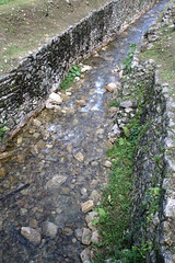 Mayan Aquaduct (peterkelly) Tags: digital canon 6d gadventures mayandiscovery northamerica mexico chiapas palenquenationalpark lakamha ruins aquaduct mayan maya water stone wall stream