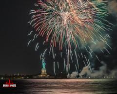 Statue Of Liberty Fireworks-2 (bkrieger02) Tags: fireworks fireworksphotography nightphotography longexposure statueofliberty libertyisland ellisisland hudsonriver brooklyn louisvalentinojrpark redhook nyc newyorkcity colors colorful waterreflections reflections canonusa teamcanon 7dmkii sigma sigmaart artlens 24105