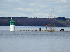 A photo of the Ottawa River's spring thaw flood overwhelming the marina in Aylmer (Gatineau), Quebec (Ullysses) Tags: aylmermarina aylmer gatineau quebec canada spring printemps springthaw flood flooding inondation lighthouse phare ottawariver rivièredesoutaouais