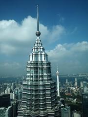 Towering over Kuala Lumpur (Hammerhead27) Tags: work office klcc construction glass metal tourist menaratower petronastower view clouds sky olympus malaysia kl kualalumpur tall architecture high building skyscraper tower