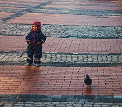 A girl and a pigeon... (erlingraahede) Tags: stranger street happy smile vsco canon eckernförde germany space alone pigeon girl