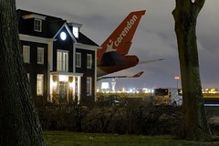 The parking spot (cigno5!) Tags: schiphol airplane aircraft 747 boeing747 corendon hotel parking parkingspot wings night corendonmission747 black lights house bizarre badhoevedorp amsterdam darktable
