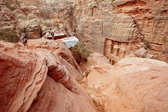 Beduin with donkey in Petra (liseykina) Tags: petra jordan ancient stone city rock travel desert sandstone canyon facade unesco architecture archeology world history east bedouin view arab red mountain culture landmark heritage carved tomb cave house home nabataeans beduin man people sand donkey animal rural tradition bdoul livehood seminomadic nomad nomadic original big stock