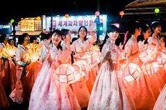 Beautiful korean girls wearing lanterns for parade (kitsunekuma) Tags: fujifilm fujinon fuji xf35mmf2 night nightshot lantern lanterns lights light beautiful beauty lotus parade buddhism buddha buddhist women girls pink red korea korean seoul insadong travelphotography travel traditional tradition