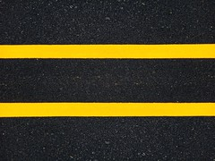 Road traffic paint Yellow on the asphalt surface (naatoy) Tags: traffic road paint safety sign street asphalt way line white urban city symbol travel transportation construction background highway pavement path danger warning transport repair direction lane industrial yellow accident drive marking surface isolated ground abstract outdoor work vehicle attention crosswalk worker man people orange single cone maintenance rubber black