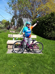 Victory! (Suzanne Guest) Tags: bicycle cycle grass bench woman victory