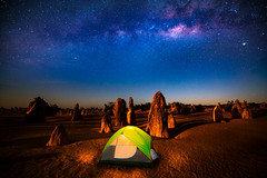 Starry sky at the Pinnacles (anekphoto) Tags: way milky nature park national australia nambung night sky western travel landscape star rock desert astronomy cervantes perth pinnacles background space outdoor tourism dark stone sand landmark long attraction stars remote universe geology formation galaxy exposure limestone outback astro pinnacle lancelin nathan starry summer yellow natural light holiday tent camping