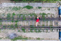 Old rail and young lady (piotr_szymanek) Tags: ania aniaz woman young skinny portrait outdoor drone fromabove legs face eyesoncamera rail red dress 1k 5k 20f 50f 10k 20k