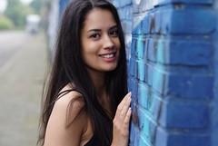Esmeralda - blue wall (e³°°°) Tags: esmeralda blue wall portrait portraiture portret posing pose femme female fille face frau smile sorria sourire stunning sonrisa smiling street antwerp antwerpen anvers belgium berchem straat straatportret lady mademoiselle woman ritratti grafitti meisje model mural