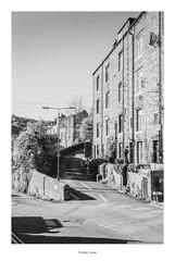Foster Lane (Rory Prior) Tags: 35mm calderdale hebdenbridge rollei35se spring yorkshire bw film fomapan100 houses road street