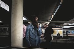 Man with Carpet (Diggoar) Tags: carpet waiting train trainstation ricohgr 28mm wideangle street streetphotography streetscene portrait candid candidportrait